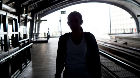 backpacker waiting for train