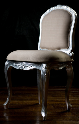 Vintage beige color chair with carved legs